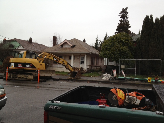 Implements of demolition along NE 63rd St between Roosevelt Way NE and 12th Ave NE. Photo by Jim O'Halloran