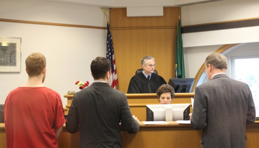 McDougall-Treacy (far left) at his arraignment hearing at the King County Courthouse on Thursday, March 14.