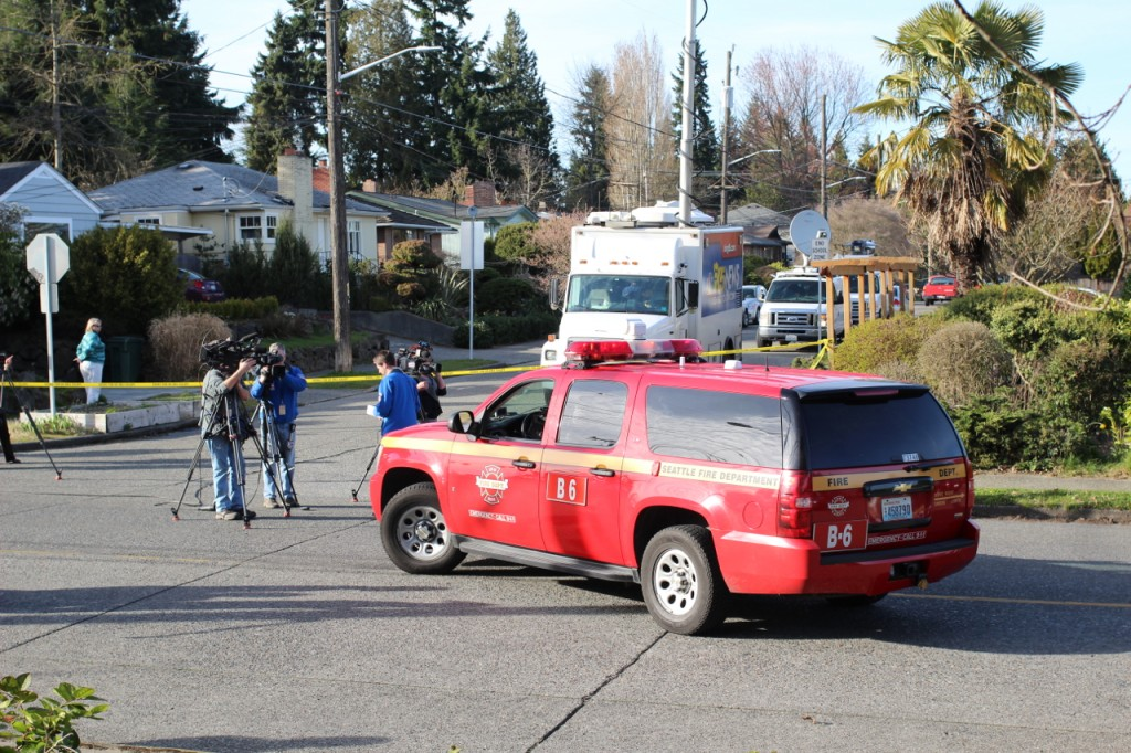 One of the 32 Seattle Fire Departments dispatched to the scene, along with one of many news vans.