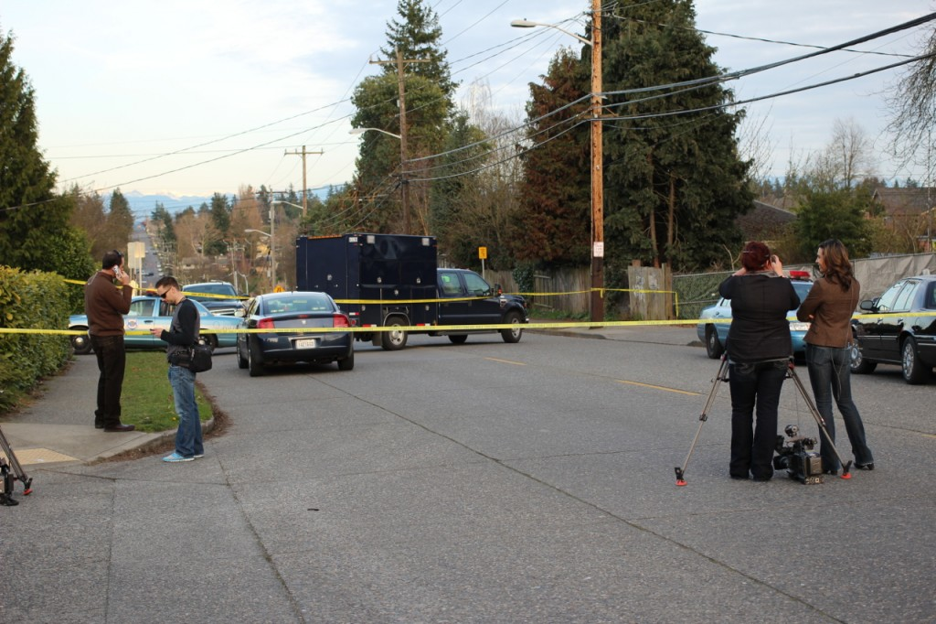 A later look at the scene from the west, large police vehicle mercifully blocking the view.