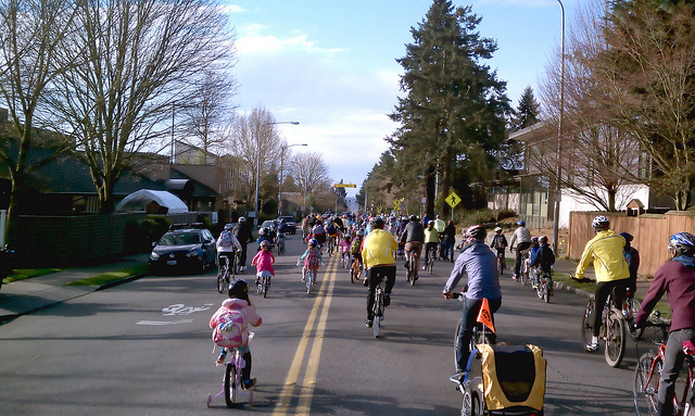 Police closed down 35th Ave NE for the annual Spring Bike to Bryant Elementary ride. Photo by Car Free Days, used with permission.