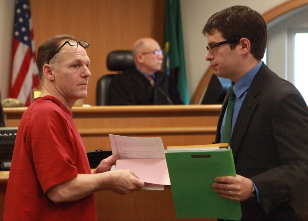 Mark Mullan, left, the repeat drunk driver accused of killing an Indiana couple and critically injuring their daughter-in-law and infant grandson at a Wedgwood intersection, is arraigned Thurs., April 11, 2013, in Seattle on two counts of vehicular homicide and two counts of vehicular assault. At right is Mullan's defense attorney Jesse Debow. Judge Ronald Kessler is at center. Ken Lambert/The Seattle Times