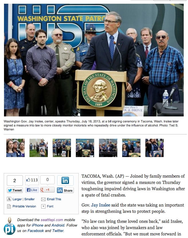 Screen grab from SeattleP-I.com's coverage of Governor Jay Inslee signing new DUI legislation into law. Click through to read the whole article, and see more photos from the event by Associated Press Photographer Ted S. Warren.