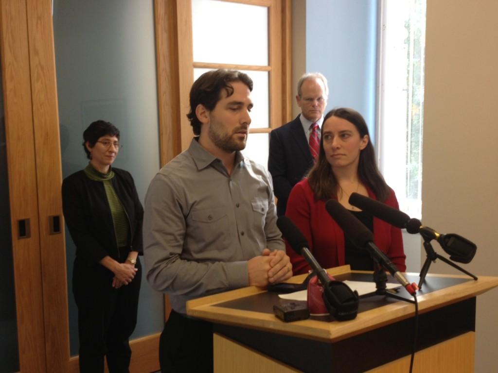 Dan and Marilyn Schulte give a statement to the media after this morning's plea hearing. King County Prosecutor Dan Satterberg stands behind them.
