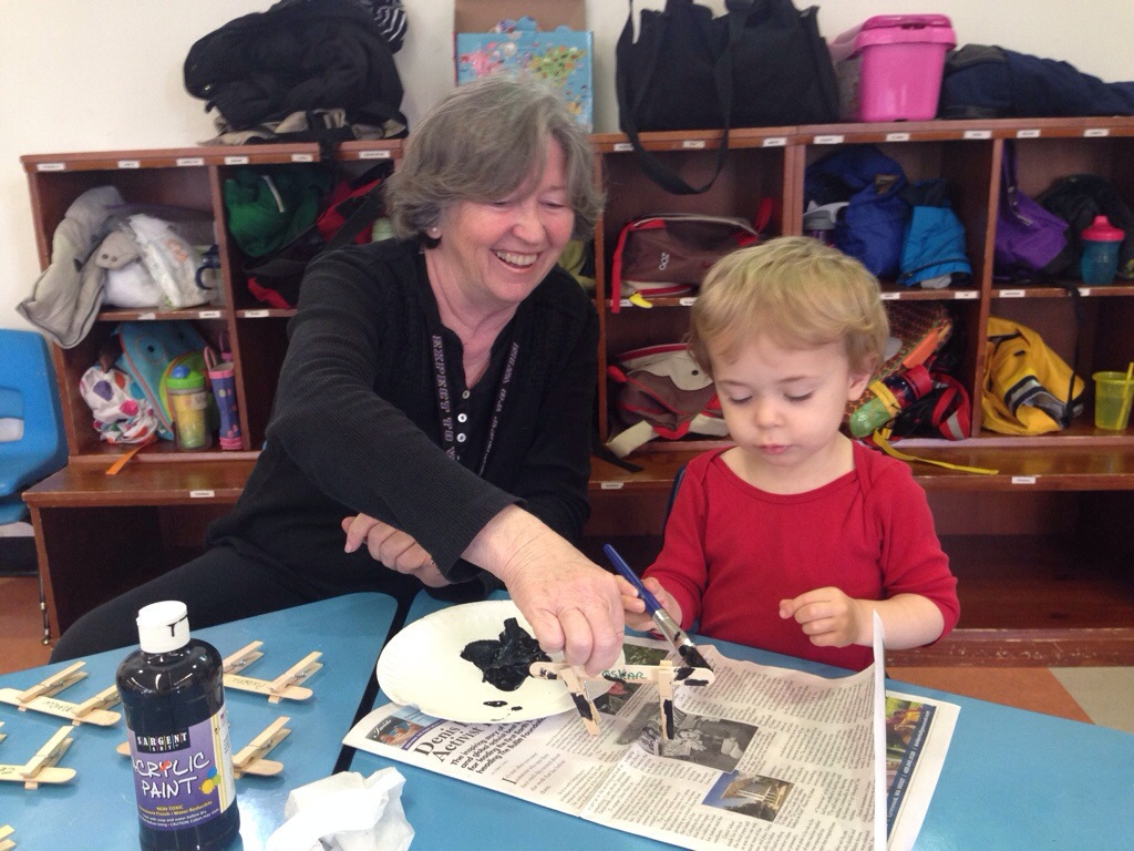 Carol Rasp works with Ravenna Blog Intern #2 on an art project in class.