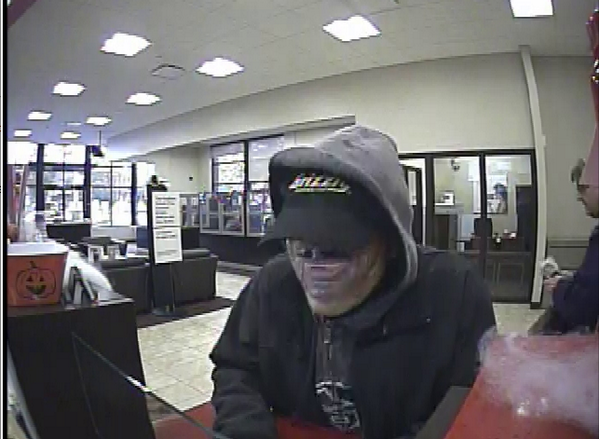 Picture taken of the suspect inside the bank, via Seattle Police.