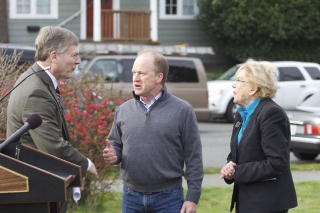 Roosevelt's Jim O'Halloran (center) speaks with Seattle City Attorney Pete Holmes (left) and City Councilmember Jean Godden (right) before the press conference.